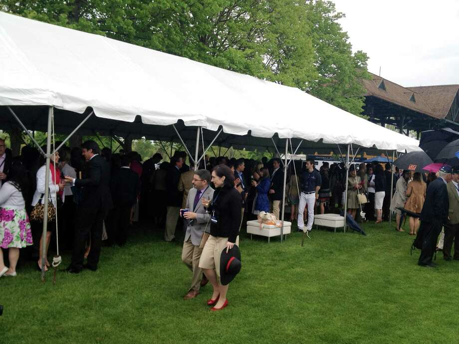 Guests gather under a tent at the Greenwich Polo Club, Wednesday, May 15, 2013. Prince Harry is in town to play in a charity match at the club to raise funds for Sentebale, a charity Harry co-founded in 2006 in memory of his late mother, Princess Diana. Photo: Neil Vigdor / Greenwich Time