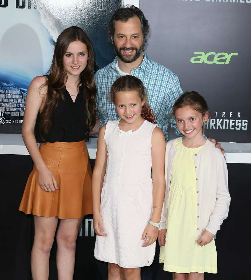 "HOLLYWOOD, CA - MAY 14:  Director Judd Apatow and (L-R) daughters Maude Apatow and Iris Apatow and guest attend the premiere of Paramount Pictures' ""Star Trek Into Darkness"" at the Dolby Theatre on May 14, 2013 in Hollywood, California.  (Photo by David Livingston/Getty Images)"
