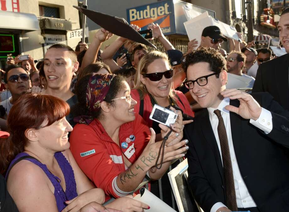 "HOLLYWOOD, CA - MAY 14:  Director/Producer J.J. Abrams poses with fans as he arrives at the Premiere of Paramount Pictures' ""Star Trek Into Darkness"" at Dolby Theatre on May 14, 2013 in Hollywood, California.  (Photo by Kevin Winter/Getty Images for Paramount Pictures)"