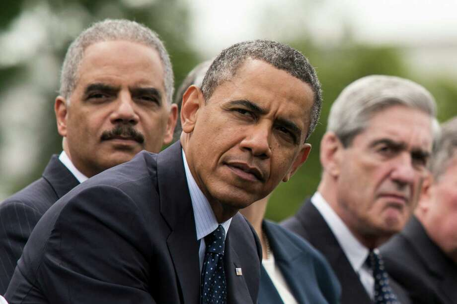 "How can we trust Attorney General Eric Holder (left, with President Barack Obama and FBI Director Robert Mueller) that  news leaks ""put the American people at risk""?   The administration's seizure of Associated Press phone records was over the top and dangerous. Photo: Drew Angerer, New York Times / NYTNS"