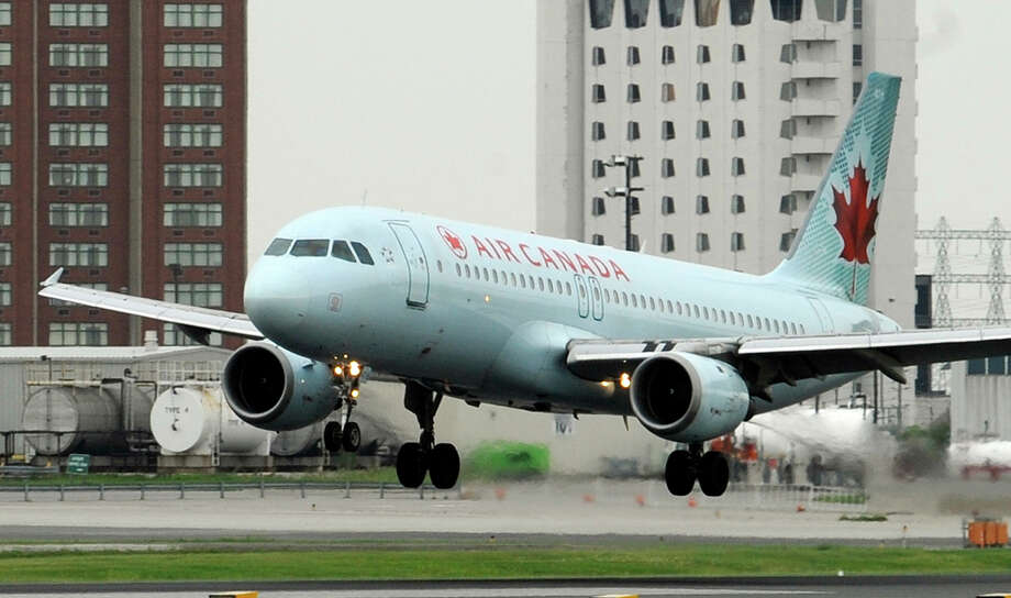 An Air Canada Airbus A320 lands at Pearson Airport in Toronto. Photo: TONY BOCK, TORONTO STAR / Toronto Star 2010