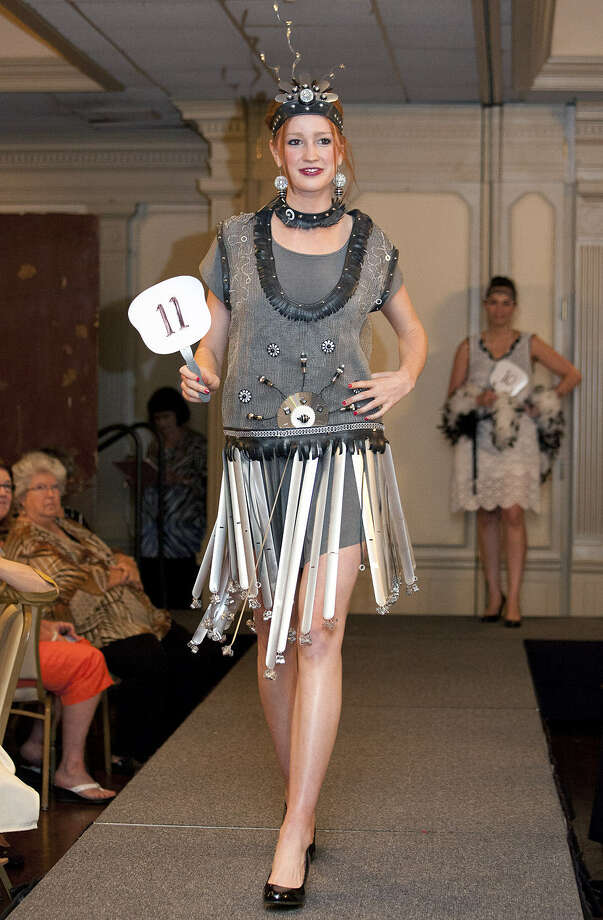 A model walks the runway in a slats-accented flapper dress by Dale Jenssen. Photo: Jamie Karutz / For The Express-News