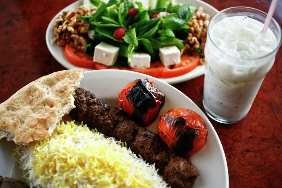 The Sultani, a skewer of beef Kubideh and a skewer of beef Barg along with white rice, the Special Herb Plate and a cup of Doogh, a yogurt drink, at Kasra Persian Grill Tuesday, June 15, 2010, in Houston.