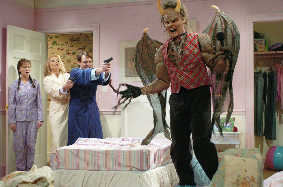 "Amy Poehler as Casey, Annette Bening as mother, Will Forte as Hank, father, Bill Hader as a monster during ""Monster Under the Bed"" skit on December 9, 2006. Photo: NBC / 2012 NBCUniversal, Inc."