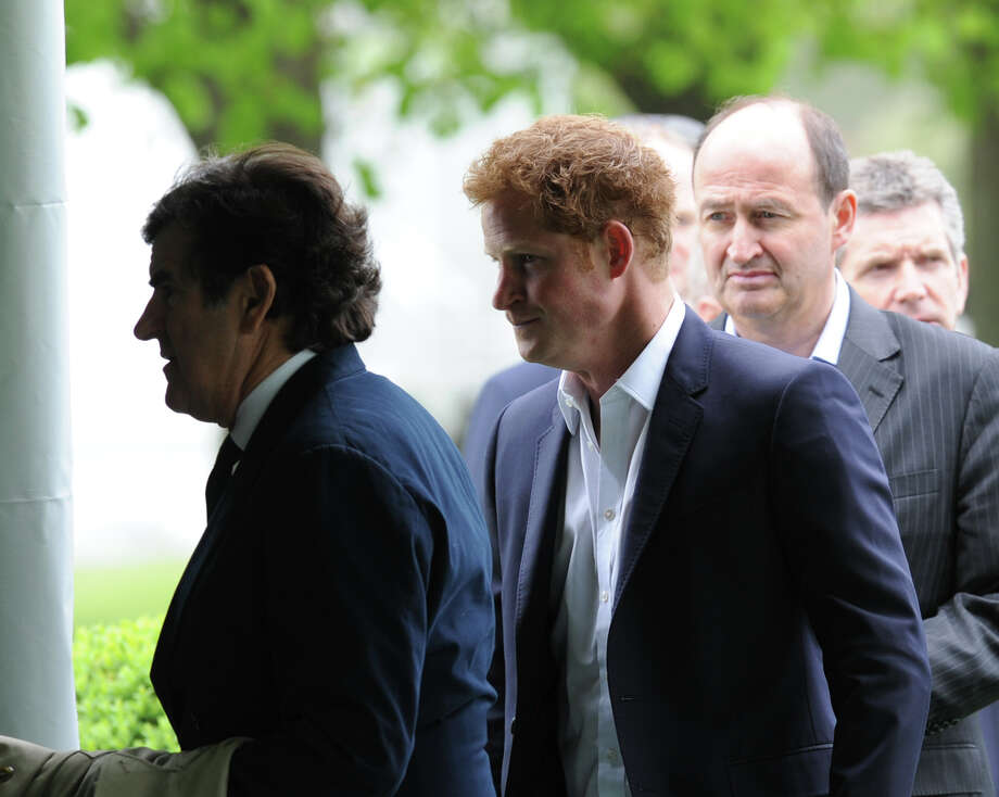 AT center, Prince Harry during the Sentebale Polo Cup festivities at the Greenwich Polo Club, Wednesday, May 15, 2013. The polo match is being played to raise funds for Sentebale, a charity Prince Harry co-founded in 2006 in memory of his late mother, Princess Diana. Photo: Bob Luckey / Greenwich Time