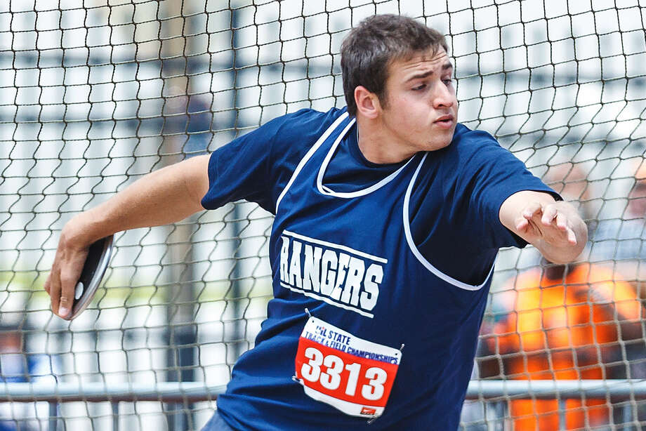 Smithson Valley's Zach Oliva releases the disc in the 5A Discus throw Saturday during the UIL State track meet at Mike Myers Stadium in Austin. Oliva took gold in the event with a throw of 165 feet, 5 inches.