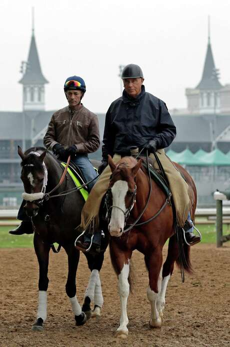 Trainer D. Wayne Lukas (right) trots with Oxbow and jockey Gary Stevens. Oxbow, at 15-1 odds for the Preakness, was sixth in the Kentucky Derby. Photo: Charlie Riedel, Associated Press / AP