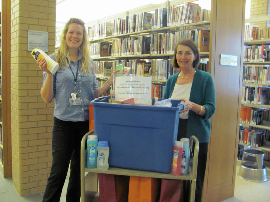 The Darien Domestic Abuse Partnership recently collected donations from community members with help from the Darien Library. Above, Erin Shea, Darien Library, and Candy Bartlett, Darien Domestic Abuse Partnership, transfer the donations collected at the library to the two safe houses run by the Domestic Violence Crisis Center. The DVCC serves seven local communities and provides key resources for those experiencing  domestic abuse including, (as well as safe houses),  counseling and legal support. The DVCC is on call 24 hours a day through its hotline at 888-774-2900 and its website, www.dvccct.org. Photo: Contributed Photo