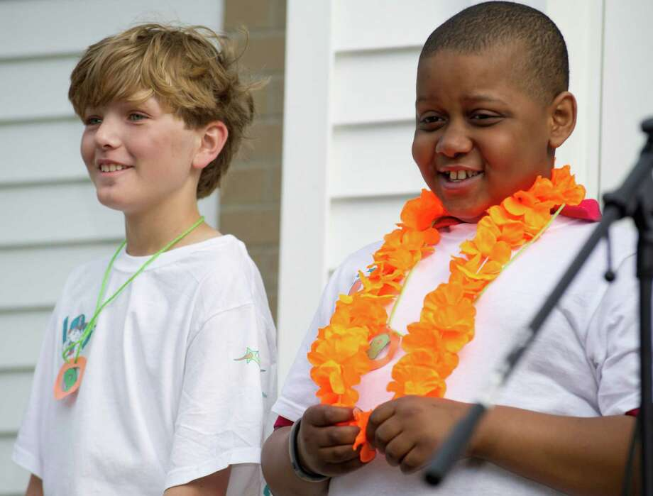 "Kyle Markes, right, smiles as he stands next to classmate William Staniar, left, during ""5B Cares"" at New Canaan Country Day School on Wednesday, May 15, 2013. Photo: Lindsay Perry / Stamford Advocate"