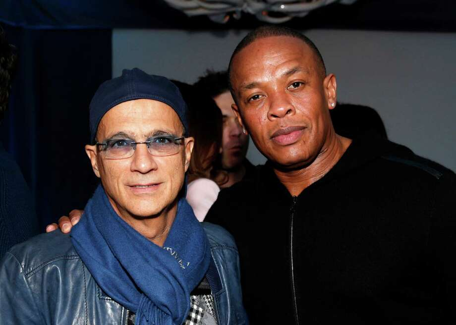 FILE - This Feb. 10, 2013 file photo shows music industry entrepreneur Jimmy Iovine, left, and hip-hop mogul Dr. Dre at a Grammy Party in Los Angeles. Dre, whose real name is Andre Young, and Iovine have donated a combined $70 million to create a new institute at the University of Southern California, the school announced Tuesday, May 14.   (Photo by Todd Williamson/Invision/AP, file) Photo: Todd Williamson