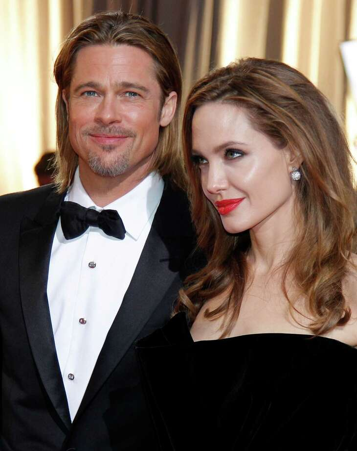 "FILE - This Feb. 26, 2012 file photo shows actors Brad Pitt, left, and Angelina Jolie at the 84th Academy Awards in the Hollywood section of Los Angeles. Pitt says it was important for his partner, Angelina Jolie, to share her story about having her breasts removed to avoid cancer ""and that others would understand it doesn't have to be a scary thing."" In an interview in USA Today on wednesday, May 15, 2013, the actor said: ""In fact, it can be an empowering thing, and something that makes you stronger and makes us stronger.""  (AP Photo/Amy Sancetta, file) Photo: Amy Sancetta"