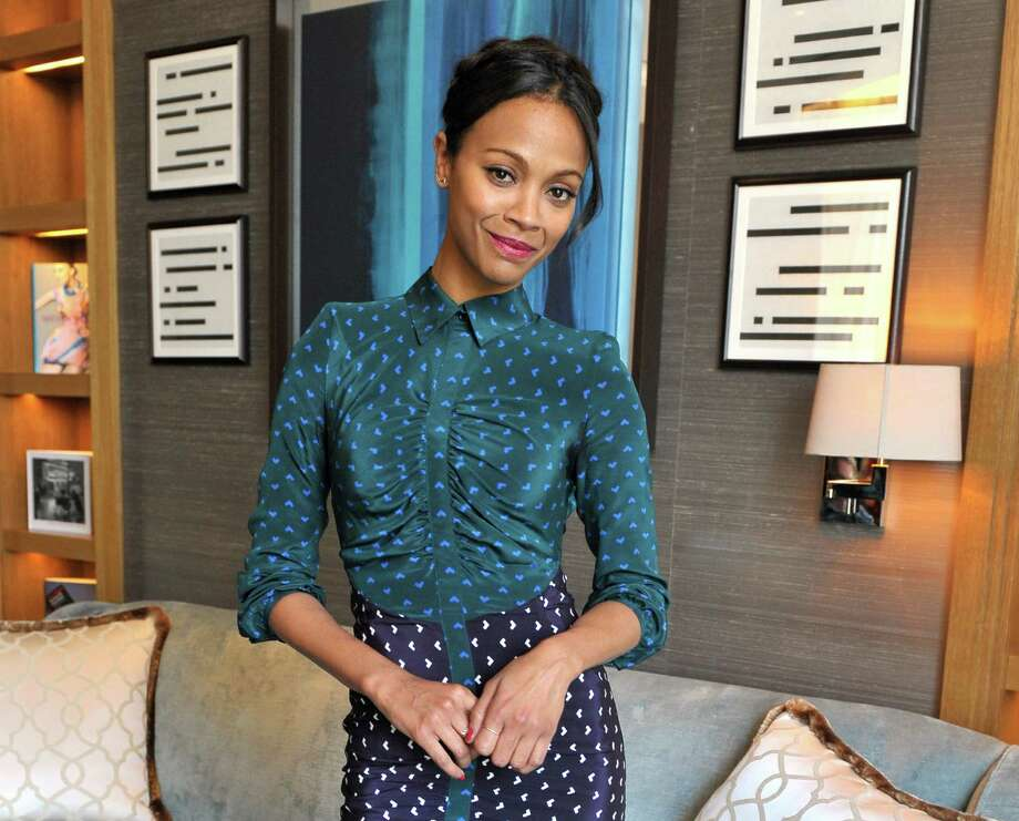 "FILE - In this Saturday, May 4, 2013 file photo, Zoe Saldana poses for a portrait session at the Corinthia Hotel in London. The 34-year-old star of ""Avatar"" and ""Star Trek"" plays pianist, singer and activist Nina Simone in the forthcoming biopic ""Nina."" (Photo by Richard Chambury/Invision/AP, File) Photo: Richard Chambury"