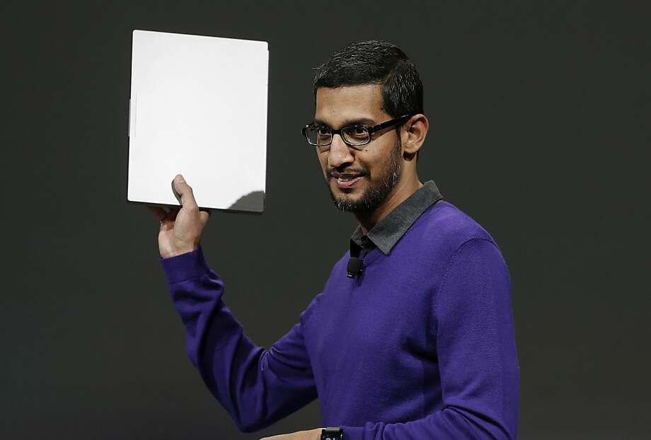 Sundar Pichai, senior vice president, Chrome and Apps at Google, holds a Google Chromebook Pixel laptop computer at Google I/O 2013 in San Francisco, Wednesday, May 15, 2013.  Photo: Jeff Chiu, Associated Press
