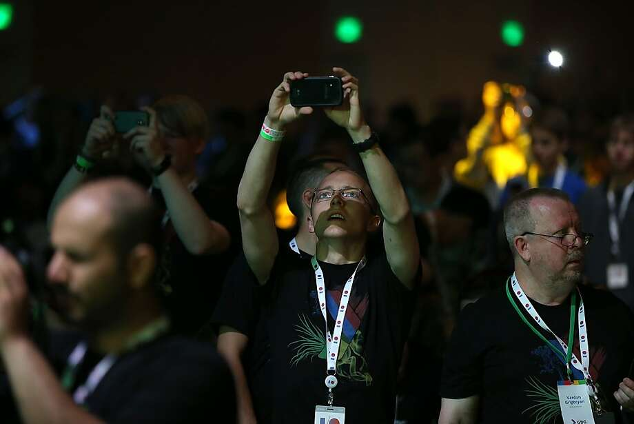 Attendees use camera phones to take pictures before the start of the opening keynote at the Google I/O developers conference at the Moscone Center on May 15, 2013 in San Francisco, California.  Thousands are expected to attend the 2013 Google I/O developers conference that runs through May 17. Photo: Justin Sullivan, Getty Images