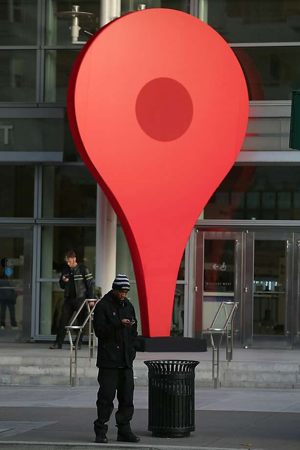 A man stands next to an oversized Google map marker pin as attendees wait to enter the Google I/O developers conference at the Moscone Center on May 15, 2013 in San Francisco, California.  Thousands are expected to attend the 2013 Google I/O developers conference that runs through May 17. Photo: Justin Sullivan, Getty Images