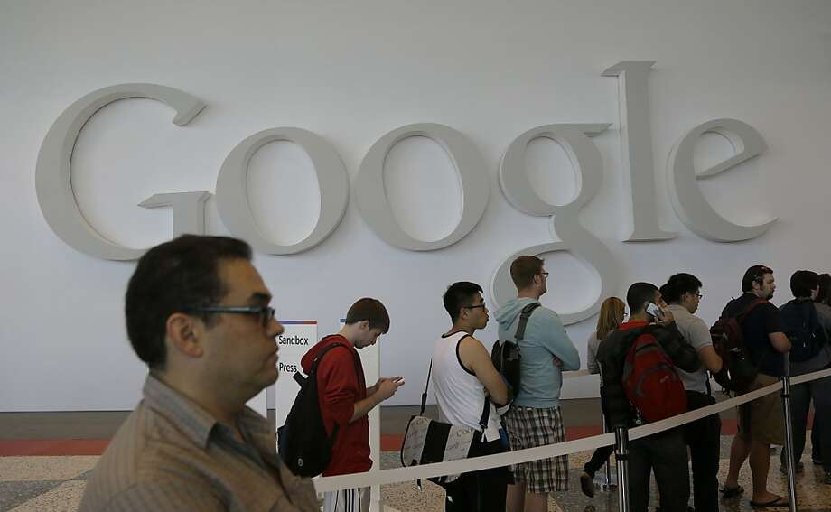 People line up for registration at Moscone Center for the Google I/O 2013 in San Francisco, Tuesday, May 14, 2013. Photo: Jeff Chiu, Associated Press