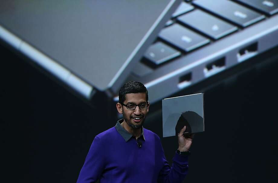 Sundar Pichai, Google senior vice president of Android, Chrome and Apps, holds a Google Chromebook Pixel as he speaks during the opening keynote at the Google I/O developers conference at the Moscone Center on May 15, 2013 in San Francisco, California. Thousands are expected to attend the 2013 Google I/O developers conference that runs through May 17. Photo: Justin Sullivan, Getty Images