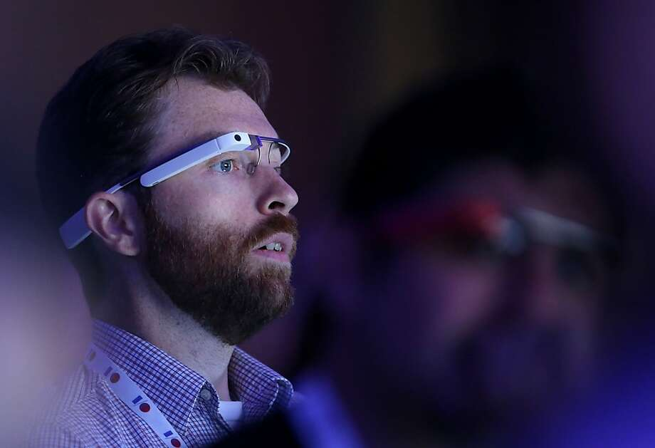 An attendee wears Google Glass as he watches the opening keynote at the Google I/O developers conference at the Moscone Center on May 15, 2013 in San Francisco, California. Thousands are expected to attend the 2013 Google I/O developers conference that runs through May 17. Photo: Justin Sullivan, Getty Images