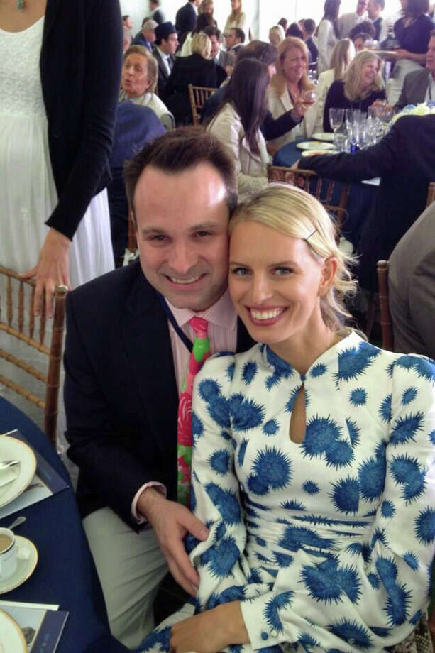 Greenwich Selectman Drew Marzullo mugs for a photo with supermodel Karolina Kurkova prior to the polo match featuring Britain's Prince Harry on Wednesday, May 15, 2013, at the Greenwich Polo Club. Photo: Neil Vigdor