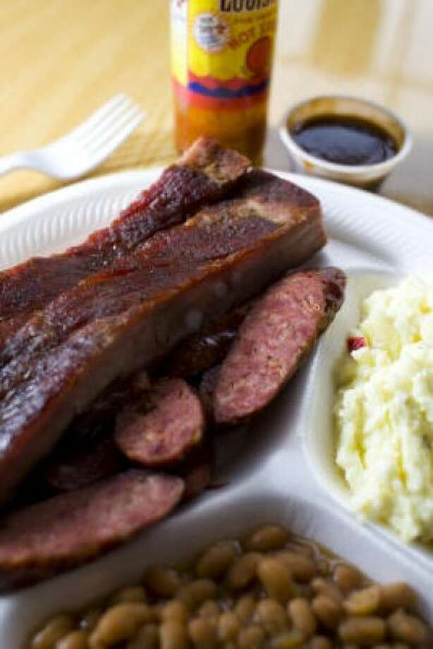 Virgie's Bar-B-Que was one of Texas Monthly's top 50. The pork ribs and sausage are served with beans and potato at 5535 North Gessner Road.  PHOTO BY NICK DE LA TORRE/HOUSTON CHRONICLE