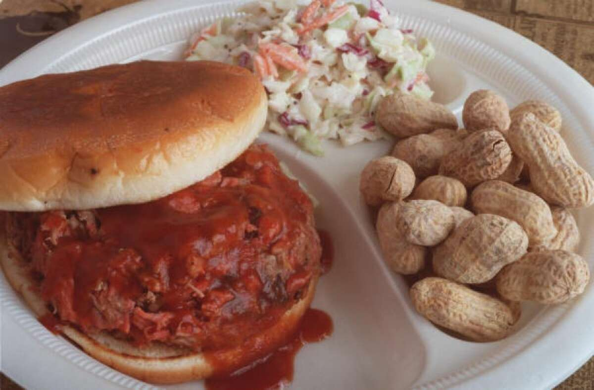 Chopped beef sandwich with a side of cole slaw and some peanuts as served at Roegels Barbecue Co.