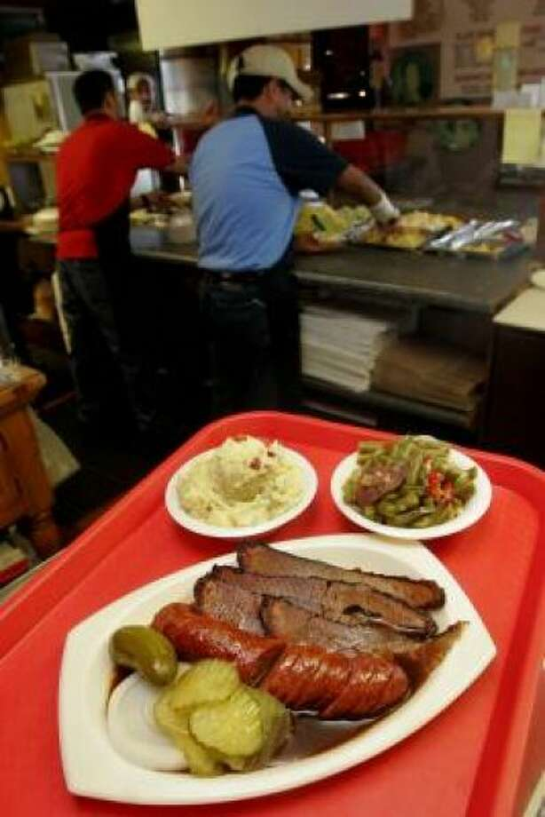 Central Texas Style Bar-B-Q Order the Jalapeno Sausage and Brisket at 4110 W. Broadway in Pearland. There is a magical blend of cultures and flavors at Central Texas Style Bar-B-Q.  PHOTO BY BILL OLIVE/FOR THE CHRONICLE