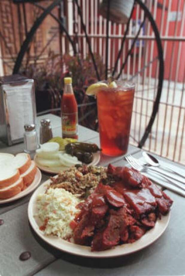 Hungry Farmer BBQ Try the 2-meat plate with ribs, sausage, cole slaw and jambalaya rice at 40 E. Crosstimbers St.  PHOTO BY BUSTER DEAN/HOUSTON CHRONICLE