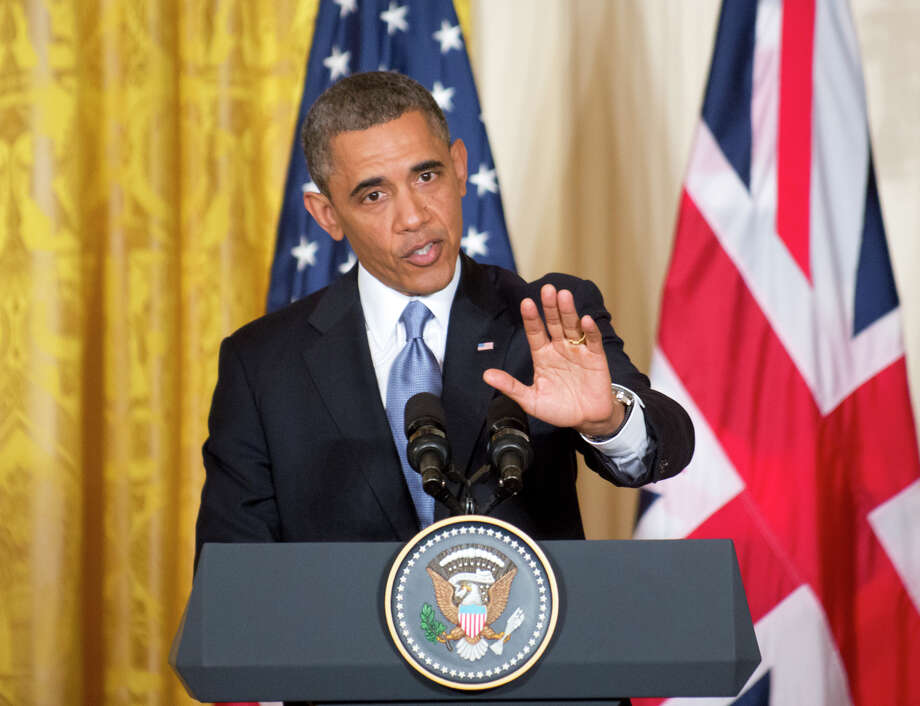 President Barack Obama gestures during a joint news conference with British Prime Minister David Cameron, Monday, May 13, 2013, in the East Room of the White House in Washington, where they talked about subjects ranging from Syria's civil war to preparations for a coming summit in Northern Ireland. Photo: J. Scott Applewhite