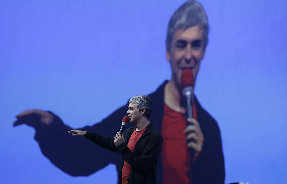 Larry Page, Google's co-founder and chief executive, speaks during the keynote presentation at Google I/O 2013 in San Francisco, Wednesday, May 15, 2013. (AP Photo/Jeff Chiu) Photo: Jeff Chiu, Associated Press