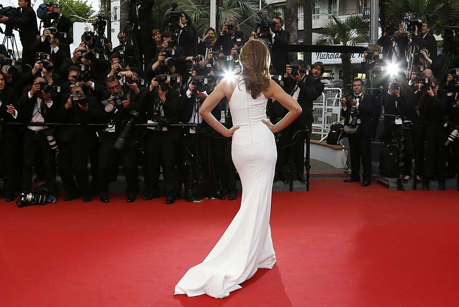 """Facing the world's best-dressed photographers:Cindy Crawford poses as she arrives for the screening of """"The Great Gatsby"""" ahead of the opening of the 66th Cannes Film Festival.  Photo: Valery Hache, AFP/Getty Images"""