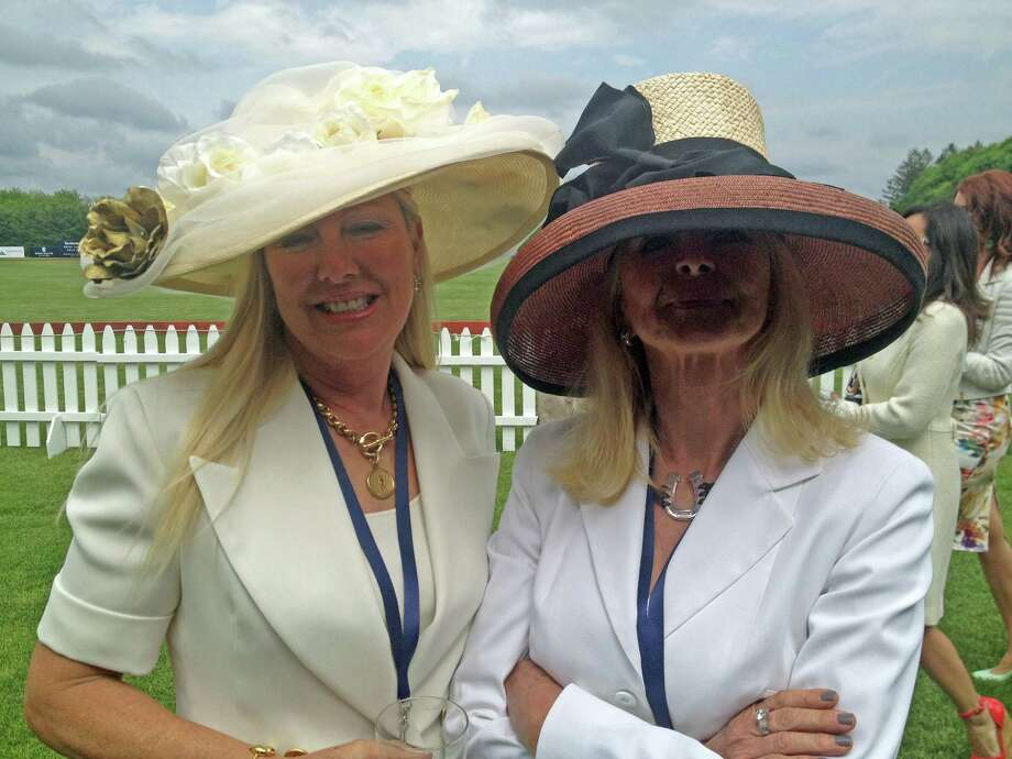 Kate Stoupas and Susannah Pask of Greenwich Riding Trails show off their hats at a polo match featuring Britain's Prince Harry on Wednesday, May 15, 2013, at the Greenwich Polo Club. Photo: John Breunig