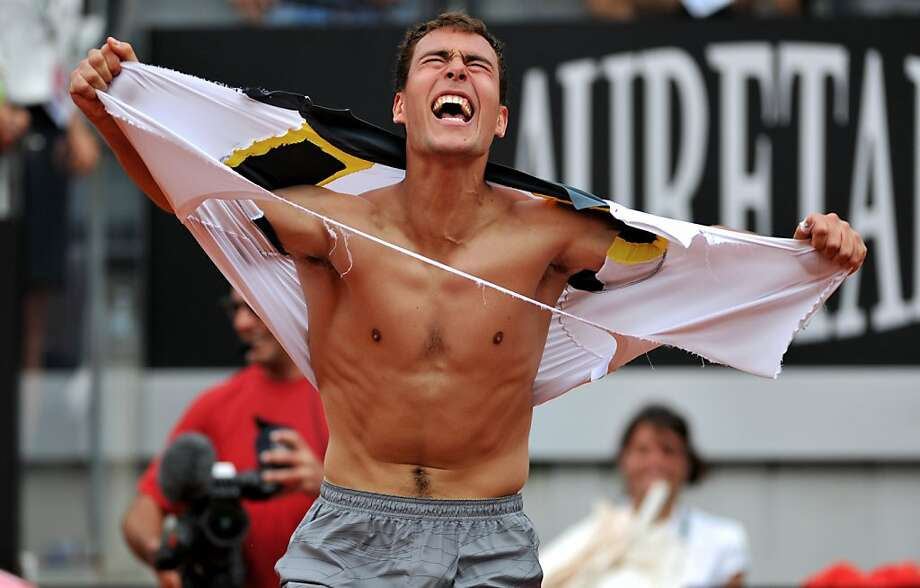You should see what he does after he wins a championship: Polish player Jerzy Janowicz rips off his shirt as he celebrates after winning  against French player Jo-Wilfried Tsonga in their ATP Rome Open tennis match.  Janowicz won 6-4, 7-6 (7/5). Photo: Tiziana Fabi, AFP/Getty Images