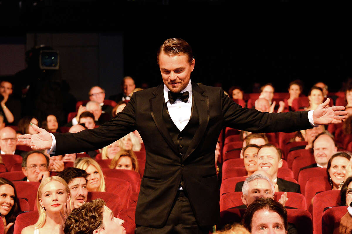Leonardo DiCaprio joins the public during the Opening Ceremony of the 66th Annual Cannes Film Festival at the Palais des Festivals on May 15, 2013 in Cannes, France.