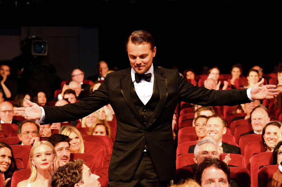 Leonardo DiCaprio joins the public during the Opening Ceremony of the 66th Annual Cannes Film Festival at the Palais des Festivals on May 15, 2013 in Cannes, France. Photo: Pascal Le Segretain, Getty Images / 2013 Getty Images