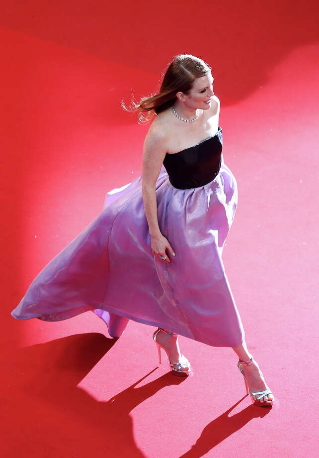 "Actress Julianne Moore arrives on May 15, 2013 for the screening of the film ""The Great Gatsby"" ahead of the opening of the 66th edition of the Cannes Film Festival in Cannes. Cannes, one of the world's top film festivals, opens on May 15 and will climax on May 26 with awards selected by a jury headed this year by Hollywood legend Steven Spielberg. Photo: LOIC VENANCE, AFP/Getty Images / 2013 AFP"