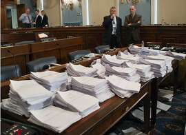 Stacks of paperwork await members of the House Agriculture Committee, on Capitol Hill in Washington, Wednesday, May 15, 2013, as it meets to consider proposals to the 2013 Farm Bill, including small cuts to the $80 billion-a-year food stamp program in an effort to appease conservatives who say the food aid has become too expensive.   (AP Photo/J. Scott Applewhite)