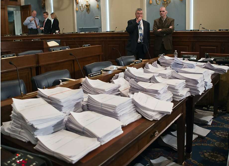 "Stacks of paperwork await the House Agriculture Committee as it considered farm bill proposals, including a ""checkoff"" program for organic producers. Photo: J. Scott Applewhite, Associated Press"