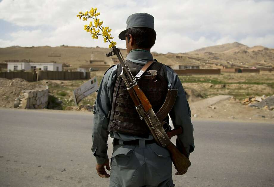 Outpost: An Afghan National Police officer mans a checkpoint on the outskirts of Maidan Shahr, Wardak province. The National Police and Army are providing security unaided by international troops now in most of Afghanistan. Photo: Anja Niedringhaus, Associated Press