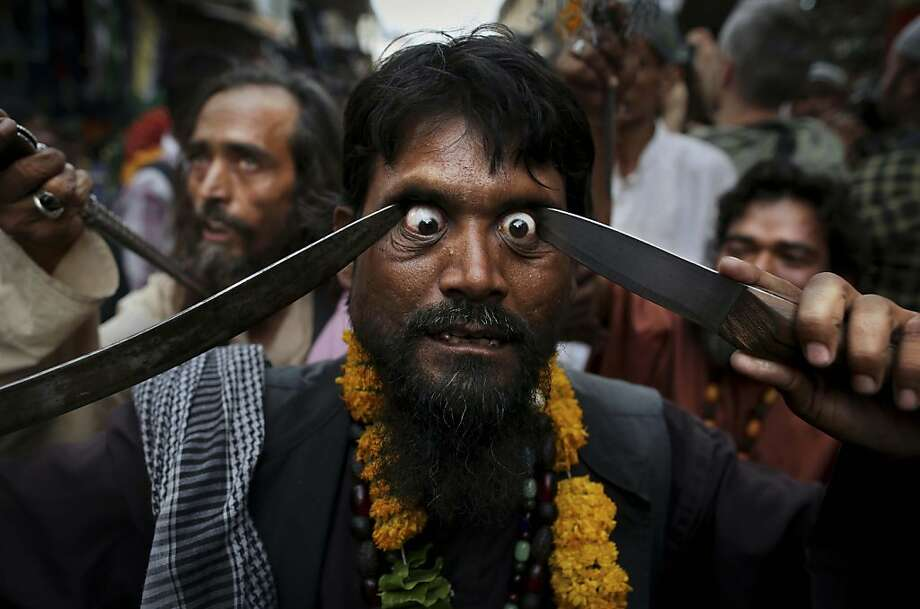 This will open your eyes: An Indian Muslim Sufi holy man flagellates himself with sharp objects during a procession at the shrine of Khwaja Moinuddin Chishti during the Urs festival in Ajmer, India.  Photo: Kevin Frayer, Associated Press