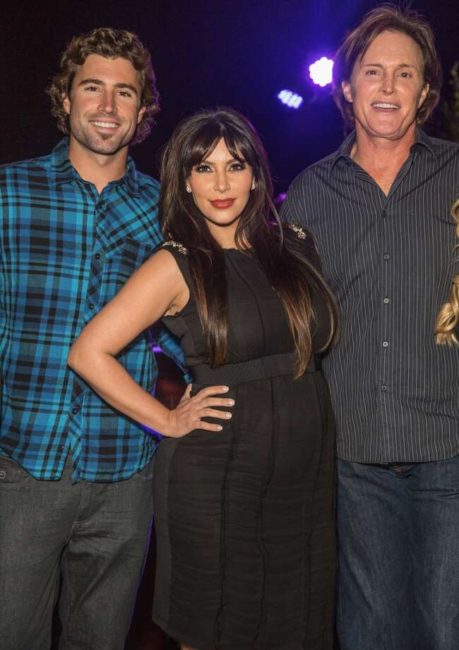 Kim Kardashian, flanked by Brody Jenner and Bruce Jenner