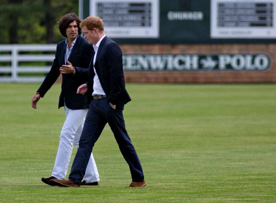 Britain's Prince Harry, right,  walks with polo player Nacho Figueras before the Sentebale Royal Salute Polo Cup charity match in Greenwich, Conn., Wednesday, 15, 2103. (AP Photo/Craig Ruttle) Photo: Craig Ruttle, AP / Associated Press