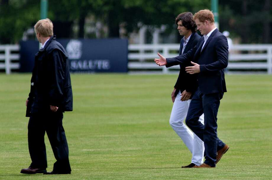 Britain's Prince Harry, right, walks with polo player Nacho Figueras before the Sentebale Royal Salute Polo Cup charity match in Greenwich, Conn., Wednesday, May 15, 2103. (AP Photo/Craig Ruttle) Photo: Craig Ruttle, AP / Associated Press