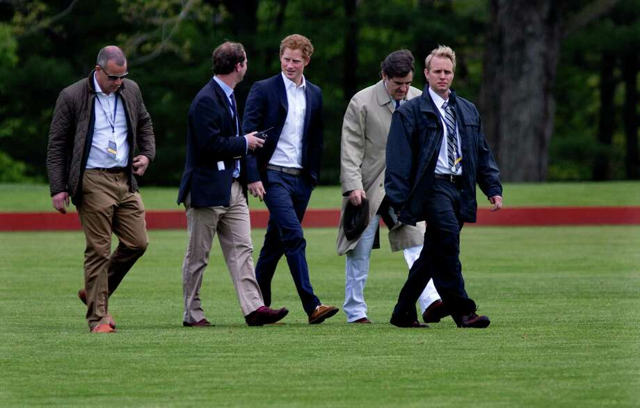 Britain's Prince Harry walks across the polo field before the Sentebale Royal Salute Polo Cup charity match in Greenwich, Conn., Wednesday, 15, 2103. Prince Harry is  is competing at the Greenwich Polo Club to benefit Sentebale, the charity he co-founded to help poor children and AIDS orphans in the small African nation of Lesotho.  (AP Photo/Craig Ruttle) Photo: Craig Ruttle, AP / Associated Press