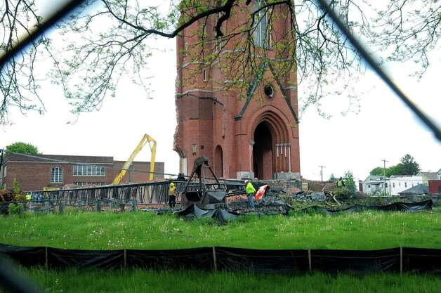 Workers continue to set up a large crane on the site of the former  St. Patrick's church on Wednesday, May 15, 2013 in Watervliet, NY.  The crane will be used to demolish the church's bell tower.   (Paul Buckowski / Times Union) Photo: Paul Buckowski
