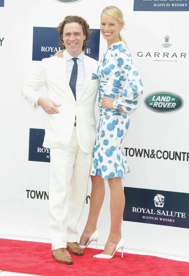 "GREENWICH, CT - MAY 15:  ""Town & Country"" Editor-in-Chief Jay Fielden and Model Karolina Kurkova attend the Sentebale Royal Salute Polo Cup during the sixth day of HRH Prince Harry's visit to the United States at Greenwich Polo Club on May 15, 2013 in Greenwich, Connecticut. HRH will be undertaking engagements on behalf of charities with which the Prince is closely associated on behalf also of HM Government, with a central theme of supporting injured service personnel from the UK and US forces.  (Photo by Jamie McCarthy/Getty Images) Photo: Jamie McCarthy, Getty Images / 2013 Getty Images"
