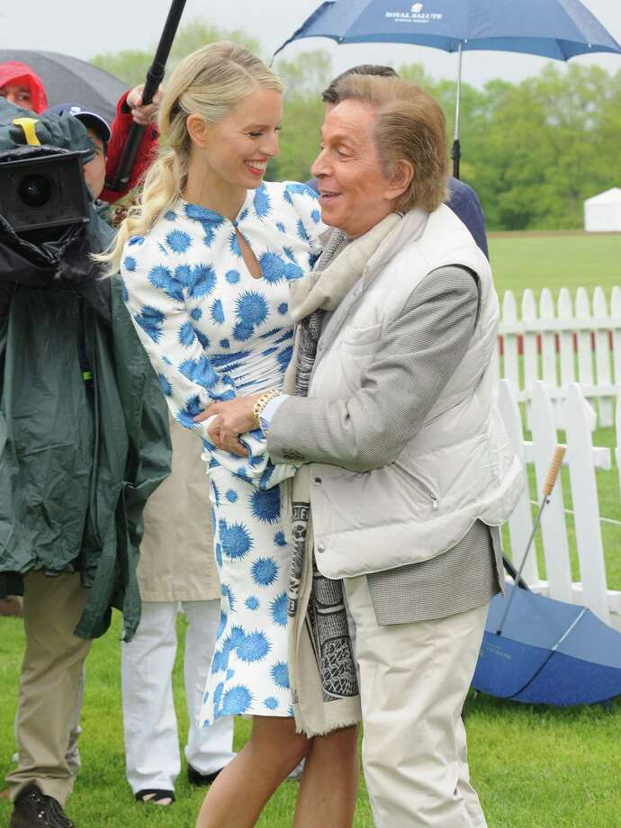 GREENWICH, CT - MAY 15:  Model Karolina Kurkova and Designer Valentino Garavani attend the Sentebale Royal Salute Polo Cup during the sixth day of HRH Prince Harry's visit to the United States at Greenwich Polo Club on May 15, 2013 in Greenwich, Connecticut. HRH will be undertaking engagements on behalf of charities with which the Prince is closely associated on behalf also of HM Government, with a central theme of supporting injured service personnel from the UK and US forces.  (Photo by Jamie McCarthy/Getty Images) Photo: Jamie McCarthy, Getty Images / 2013 Getty Images