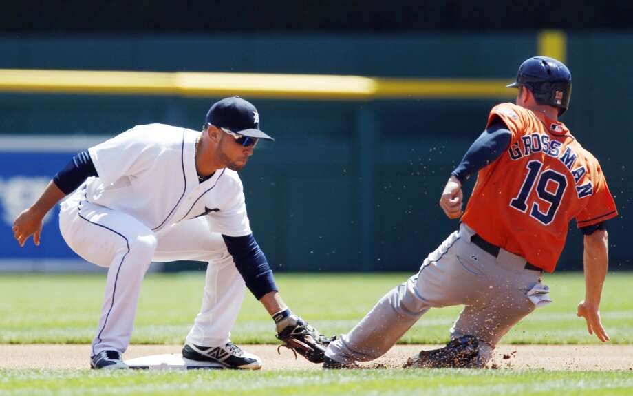 Second baseman Omar Infante tags out Robbie Grossman trying to steal second base in the first inning.