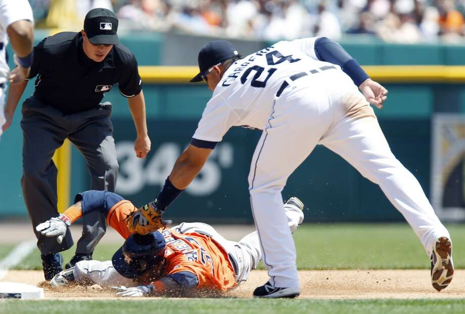 Jimmy Paredes is tagged out by Miguel Cabrera after getting caught in a rundown in the fourth inning.