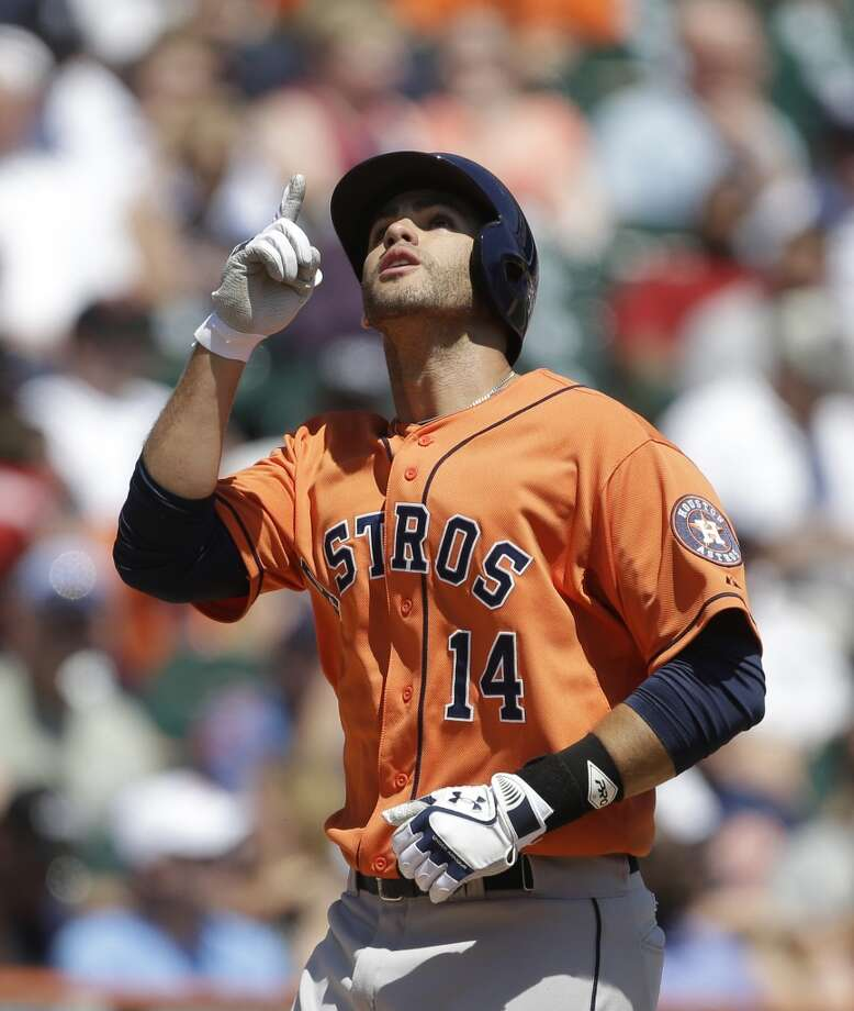 J.D. Martinez points skyward at home plate after hitting a three-run home run off Tigers pitcher Max Scherzer during the fourth inning.