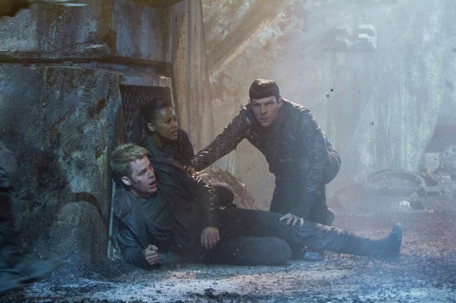 "Chris Pine, from left, Zoe Saldana and Zachary Quinto fight terrorists in ""Star Trek Into Darkness."" Photo: Zade Rosenthal, Handout / ONLINE_YES"